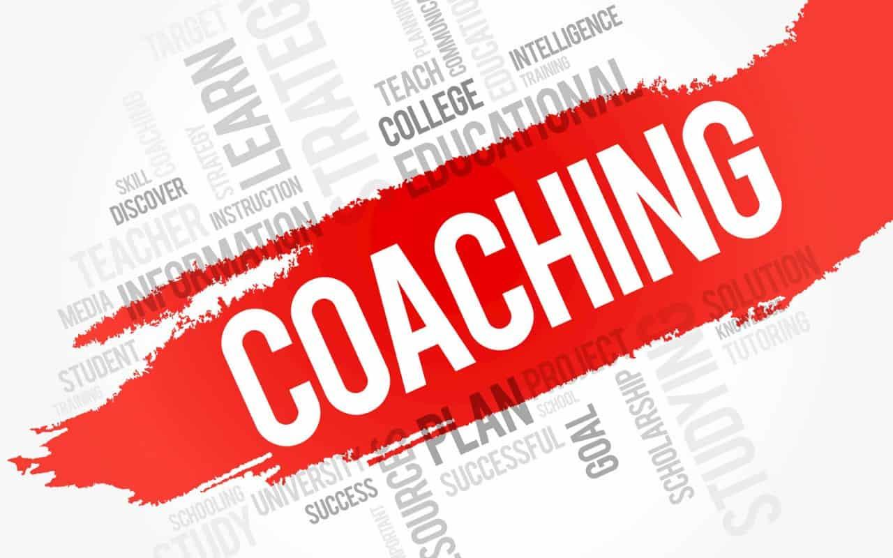 Coaching - napis na czerwonym tle