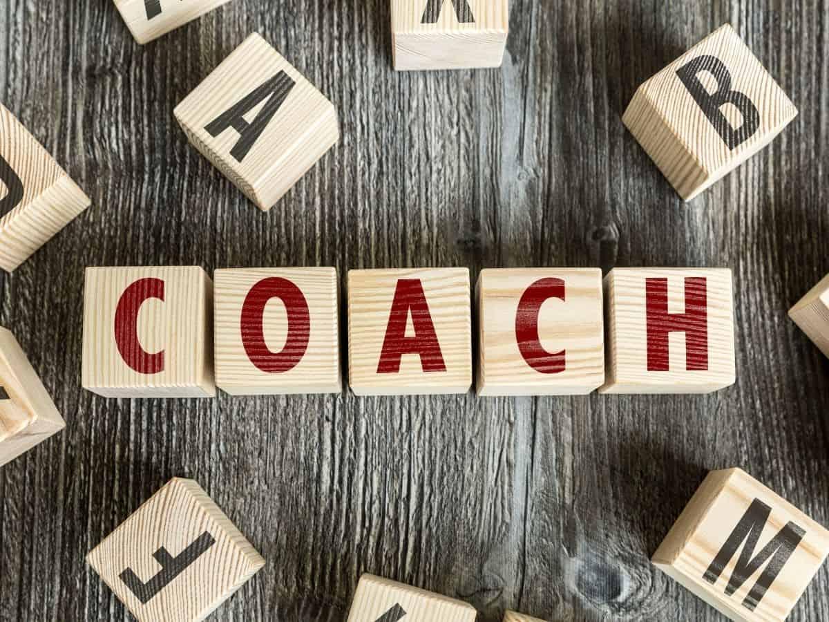 Układanka z kloców ze słowem coach